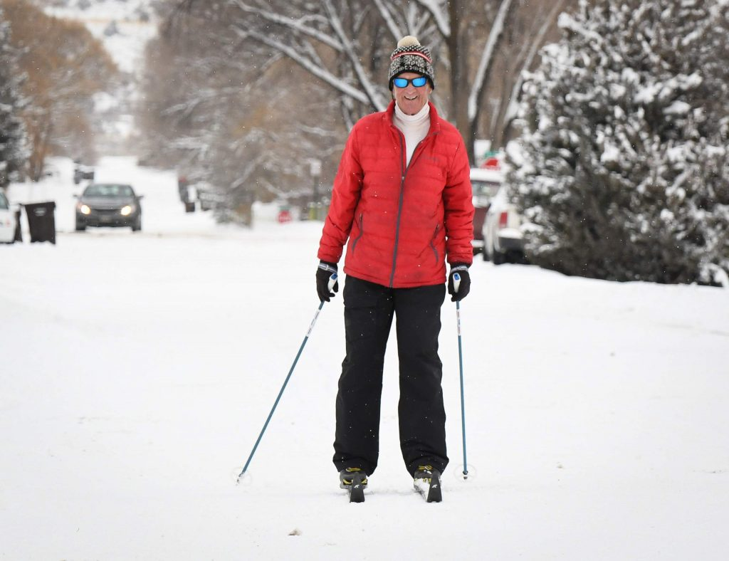 A man does some cross country skiing down a neighborhood street in downtown Silt on Friday afternoon after a snowstorm left close to a foot in the area on Thursday and over night into Friday.