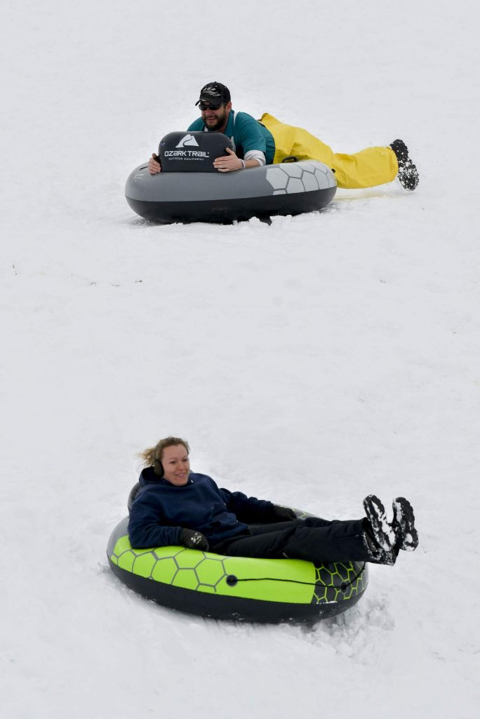 A pair of tuber flide down the freshly packed snow east of the airport Friday in Rifle. Thursday's storm dropped seven inches of new snow in western Garfield County.