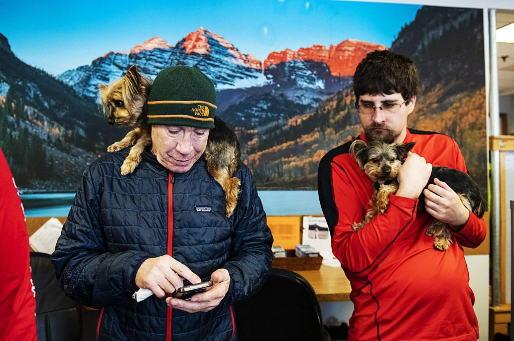 Tuvia Stein, left, and Tanner Jadwin hold Yorkshire terriers Bonnie and Clyde in the Challenge Aspen office in Snowmass on Thursday, Jan. 30, 2020. Stein said that his two small dogs are the office's therapy dogs. (Kelsey Brunner/The Aspen Times)