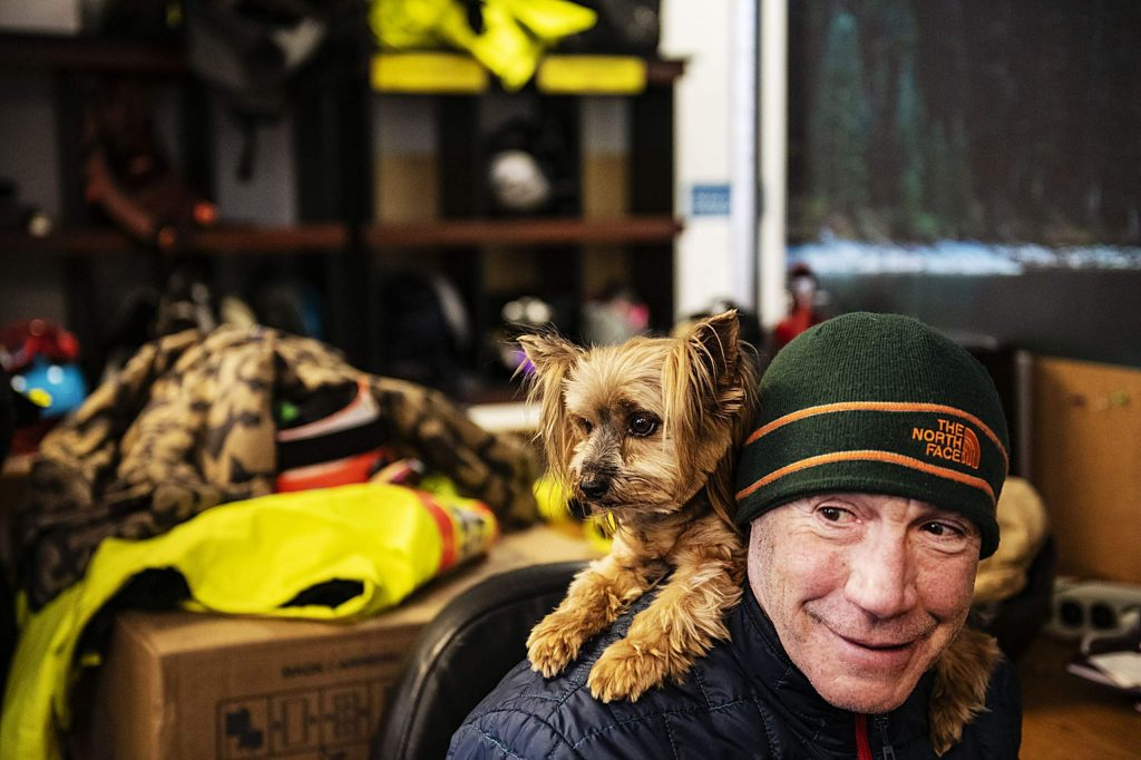 Tuvia Stein holds one of his Yorkshire terriers on his shoulders in the Challenge Aspen office on Thursday, Jan. 30, 2020. (Kelsey Brunner/The Aspen Times)