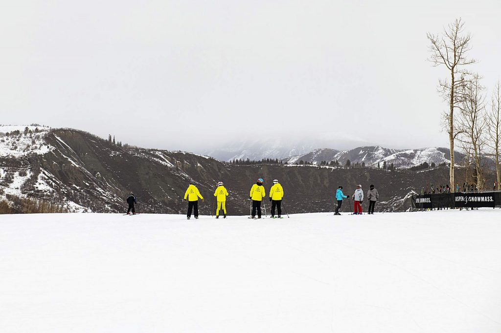 Challenge Aspen skiers make their way back to the lift while practicing at Snowmass on Thursday, Jan. 30, 2020. (Kelsey Brunner/The Aspen Times)