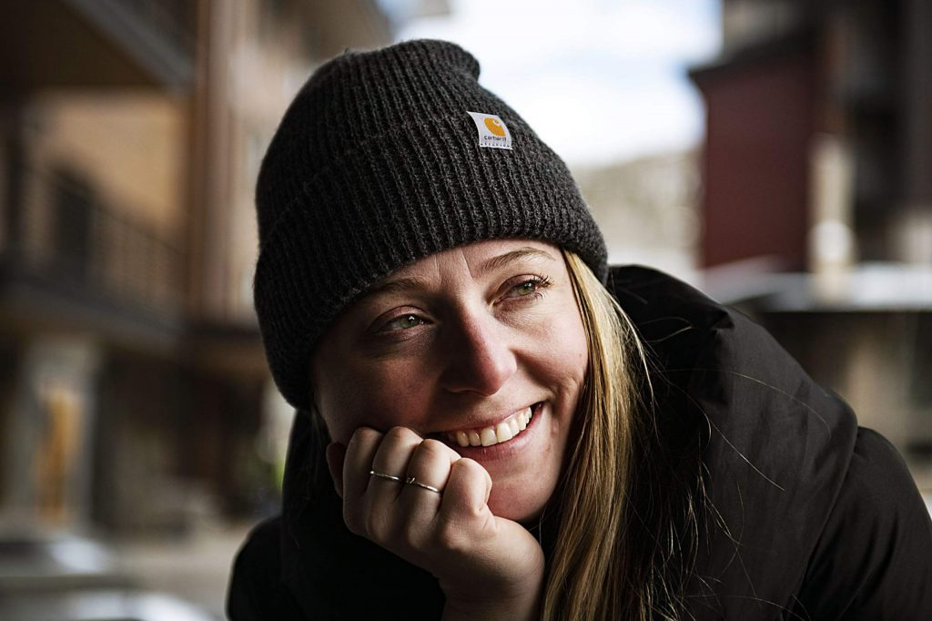 Kelly Peters talks about the opportunity to create a billboard for CORE in Snowmass while sitting outside of the Straight Line Studio in Base Village on Thursday, Feb. 13, 2020.