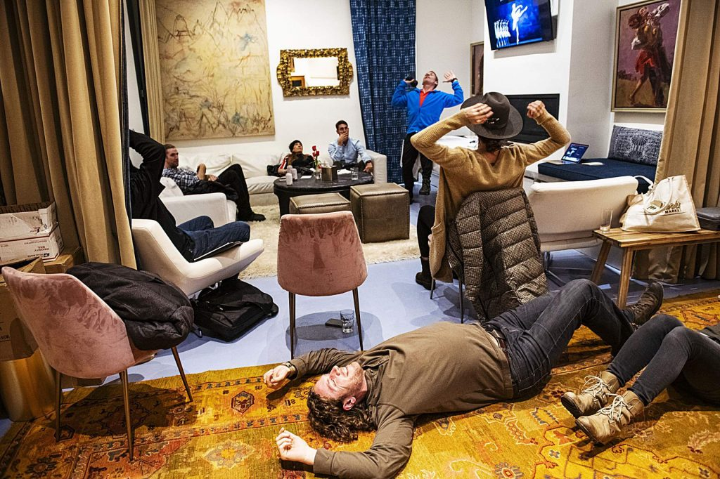 Attendees of the Wellness Wednesday at Here House test out the Vibe massage rollers while Bill Fabrocini gives a presentation on Wednesday, Feb. 12, 2020. (Kelsey Brunner/The Aspen Times)