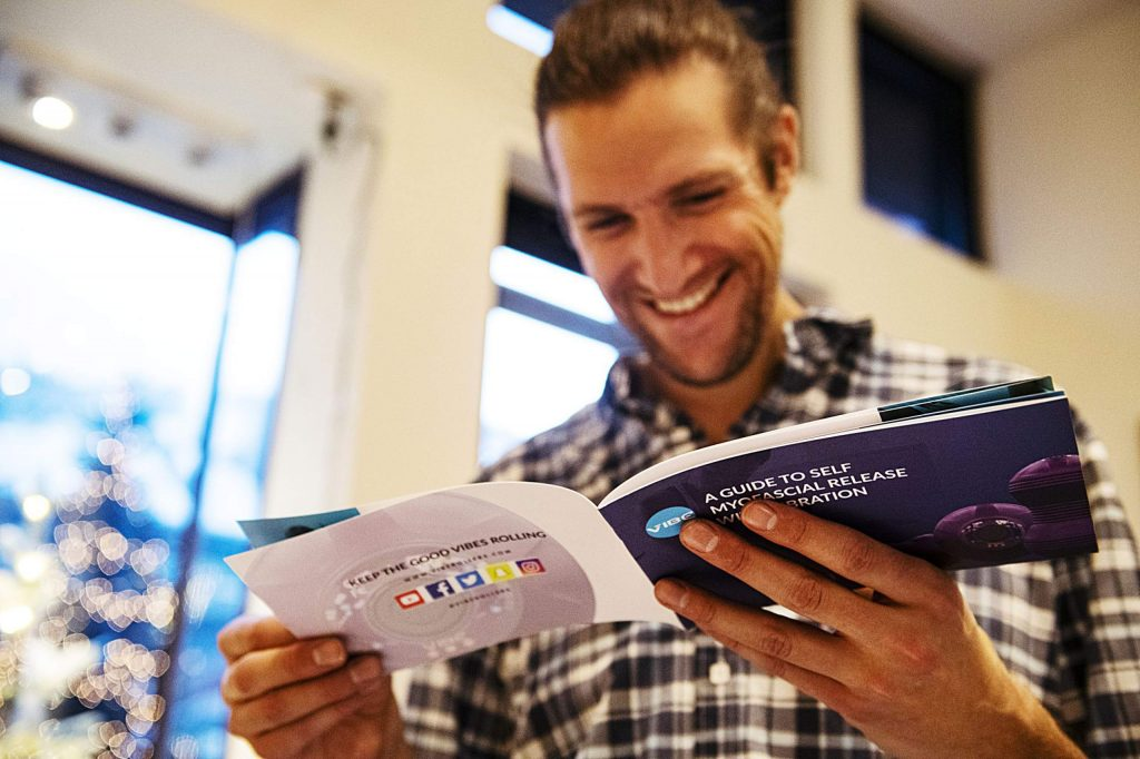 General Manage of Here House Max Ben-Hamoo reads a pamphlet for Vibe during Wellness Wednesday on Wednesday, Feb. 12, 2020. (Kelsey Brunner/The Aspen Times)