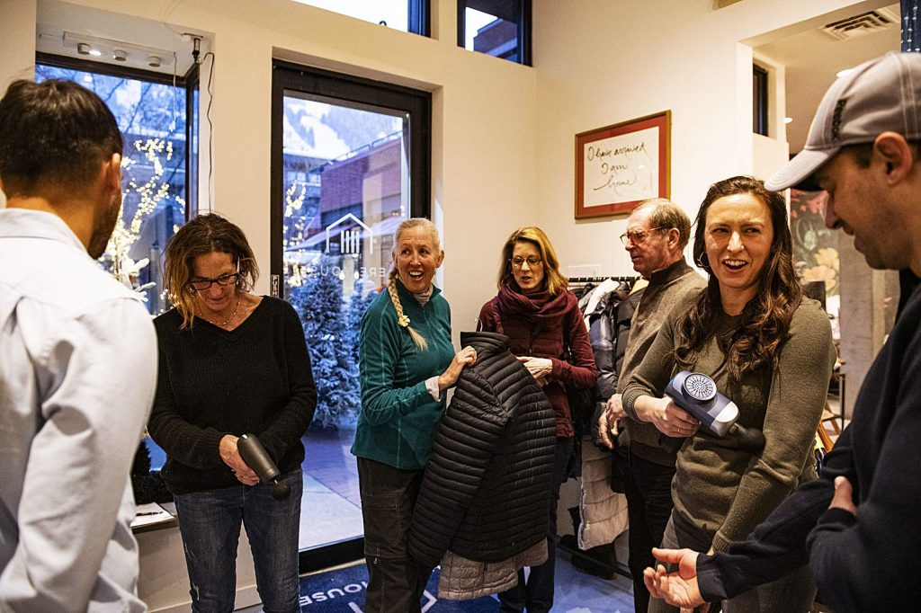 Wellness Wednesday attendees test out the Vibe massage rollers and mingle at Here House on Wednesday, Feb. 12, 2020. (Kelsey Brunner/The Aspen Times)