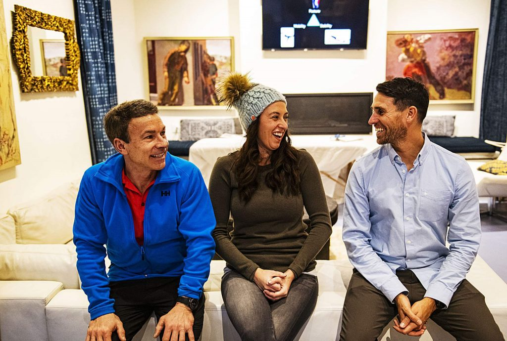 Bill Fabrocini, left, Shenna Jean and David Mills talk before the Wellness Wednesday at Here House on Wednesday, Feb. 12, 2020. (Kelsey Brunner/The Aspen Times)