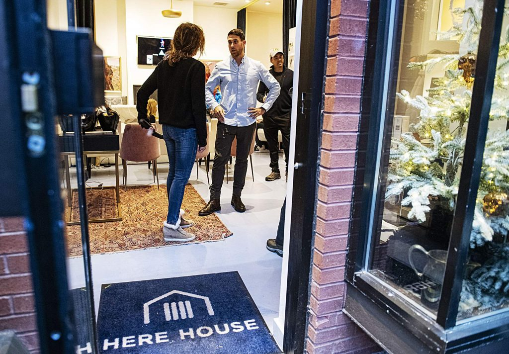 Vibe founder David Mills, center, stands in the doorway talking about his company during Wellness Wednesday at Here House on Wednesday, Feb. 12, 2020. (Kelsey Brunner/The Aspen Times)