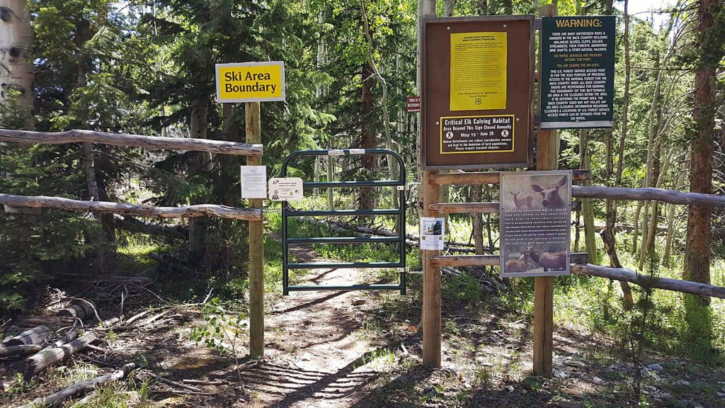This image shows the gate at Government Trail from a prior spring. Signs leave no doubt the trail is off limits due to elk calving. There is a proposal to extend the seasonal closure by one week starting this year.