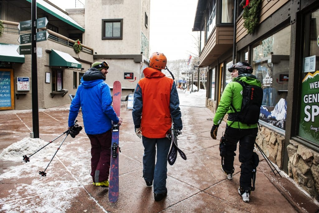 ROAM Director of Marketing Johnny Kern, left, Spencer Miller, and Jim Harris walk through the Village Mall in Snowmass on Friday, Jan. 31, 2020. Harris tried the Elevate exoskeleton from ROAM Robotics for the second time. The exoskeleton makes him feel like there's more of a possibility to keep up with friends. Harris said that before his accident skiing was his income, how he maintained friendships and both the activity he did for work and fun. He explained that after his accident his entire life was upside down, which included his ability to ski. (Kelsey Brunner/The Aspen Times)
