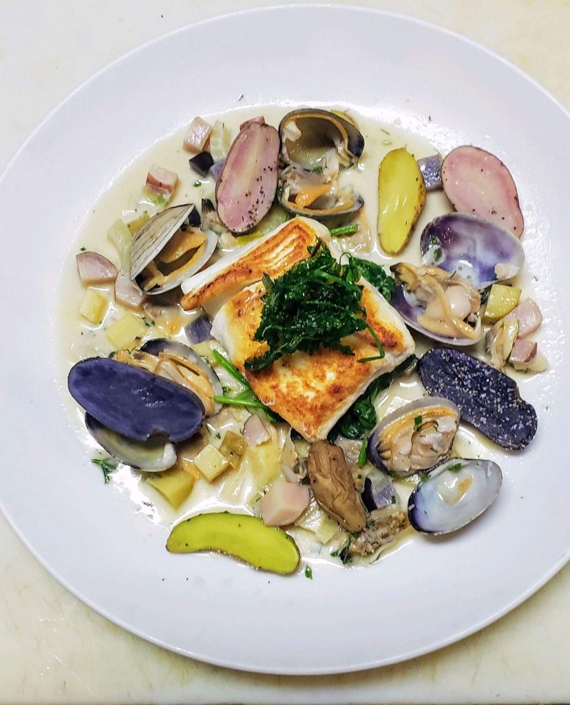Seared Alaskan halibut in littleneck clam broth with fingerling potatoes