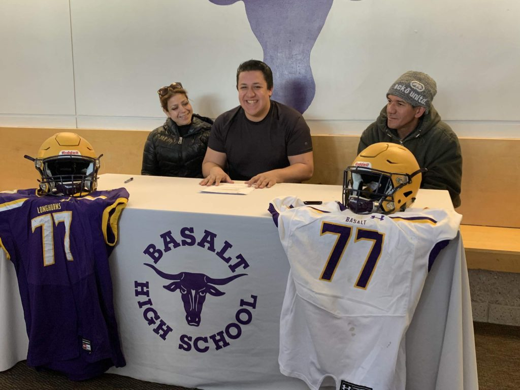 Basalt High School senior Ernesto Lopez signs Wednesday to play football for Western Colorado University.