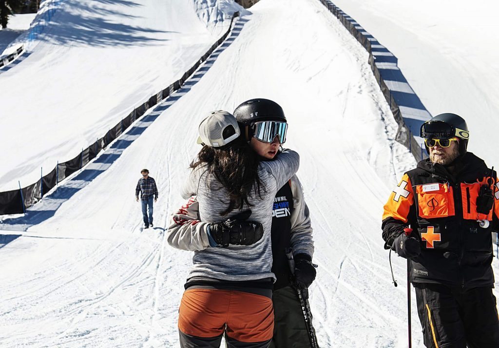 Freeskier Rodney Koford hugs his mother after taking a fall during the first run of the men's slopestyle finals at the Aspen Snowmass Freeskiing Open at Buttermilk on Friday, Feb. 14, 2020. (Kelsey Brunner/The Aspen Times)
