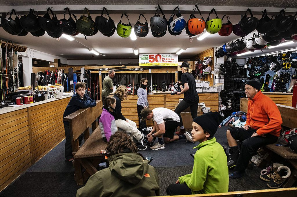 Customers of Gene Taylor's Sports get fitted for ski boots in the shop by employees in the Snowmass Village Mall shop on Saturday, Feb. 1, 2020.