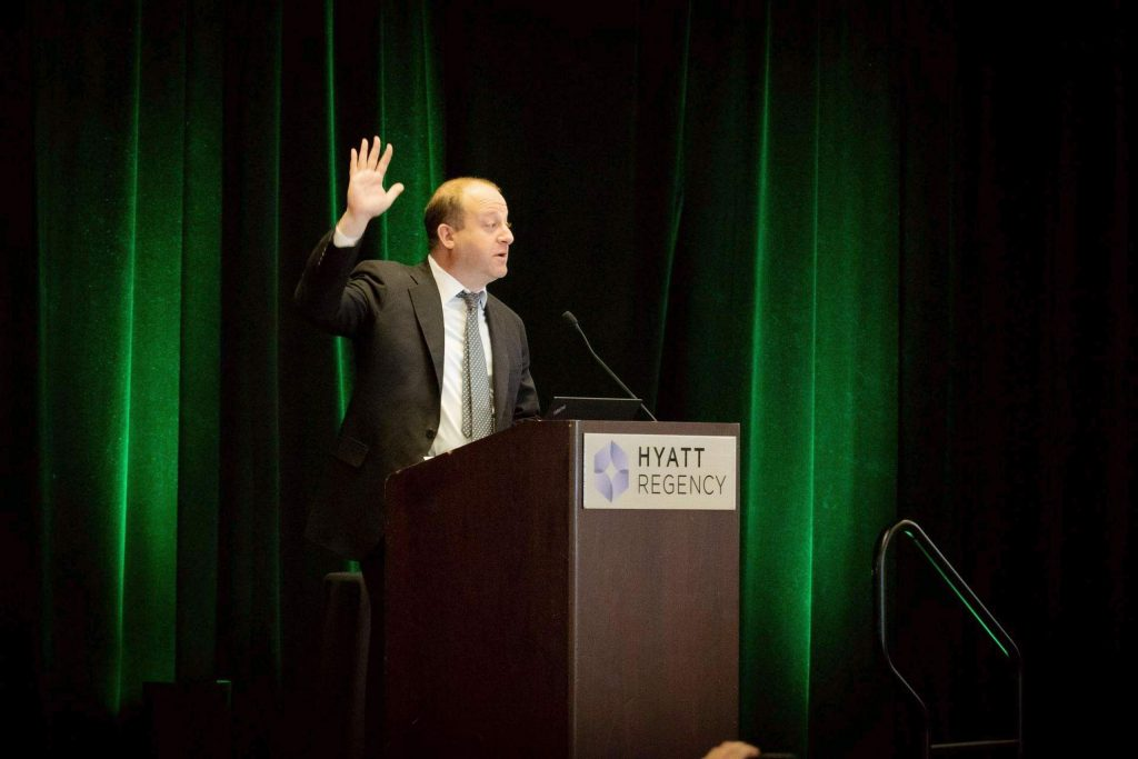 Colorado Governor Jared Polis (D) addresses the fourth annual Cannabis Sustainability Symposium in Denver on October 4, 2019.