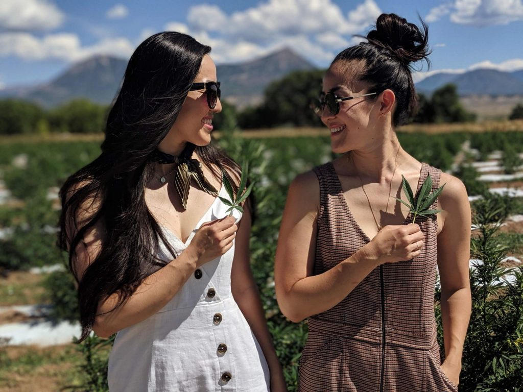 Two Cranes Botanicals co-founders and twin sisters Susun Chung and Hanna Yi at their source hemp farm in Paonia.