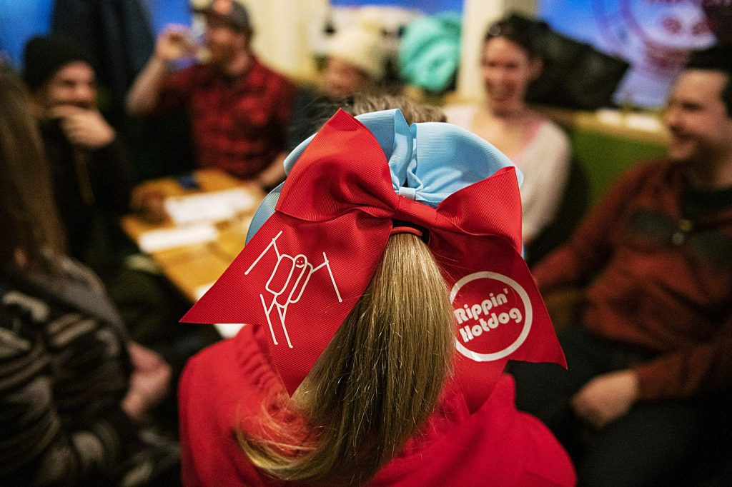 Adele La Roche sports a Rippin' Hotdog hair bow that she made herself at the New Belgium Ranger Station in the Snowmass Village Mall on Tuesday, Feb. 4, 2020. (Kelsey Brunner/The Aspen Times)