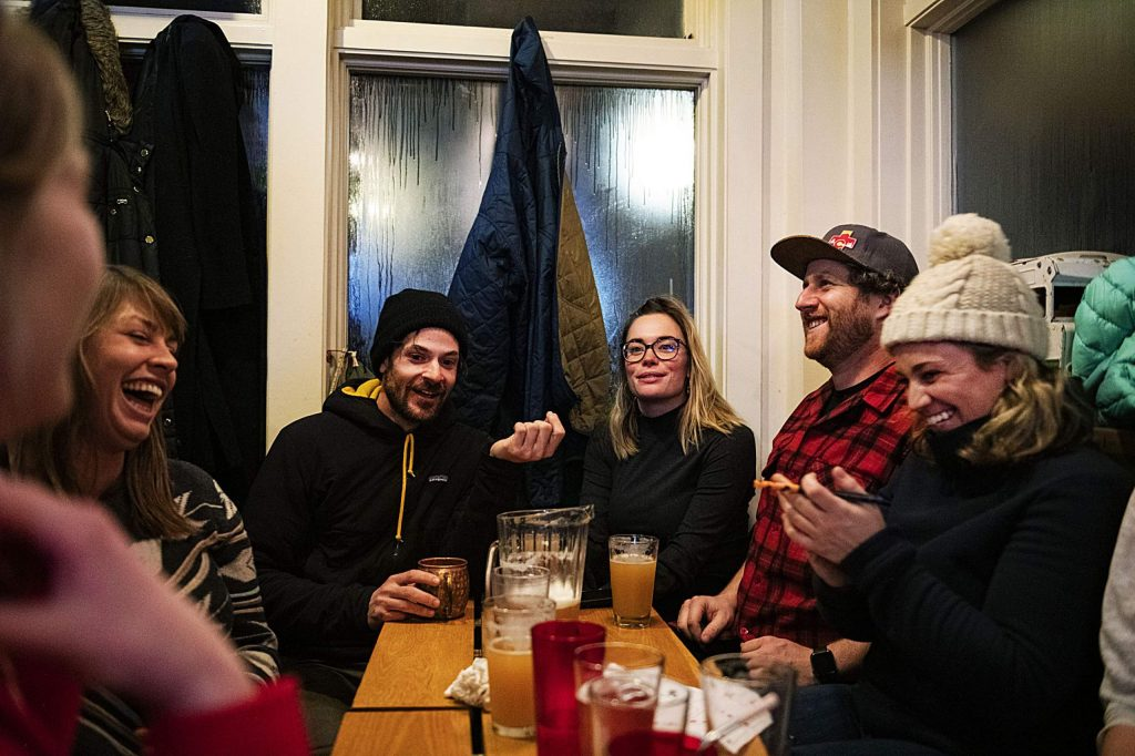 The Rippin' Hotdogs trivia team compete in a round about movies at the New Belgium Ranger Station in the Snowmass Village Mall on Tuesday, Feb. 4, 2020. (Kelsey Brunner/The Aspen Times)