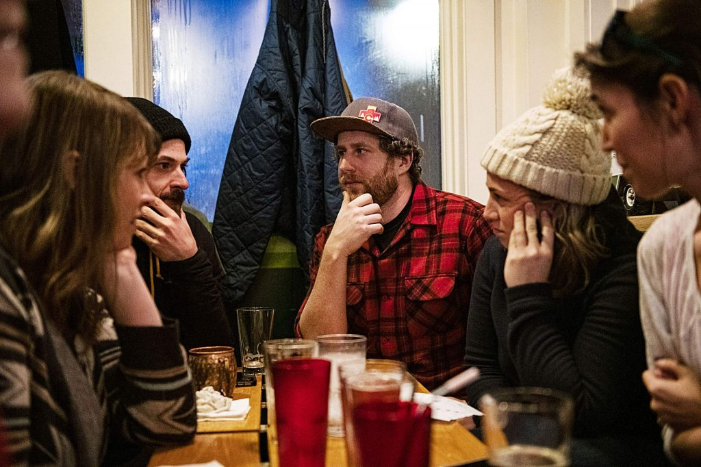 The Rippin' Hotdog trivia team thinks of an answer for one of the clues pertaining to movies at the New Belgium Ranger Station in the Snowmass Village Mall on Tuesday, Feb. 4, 2020. (Kelsey Brunner/The Aspen Times)