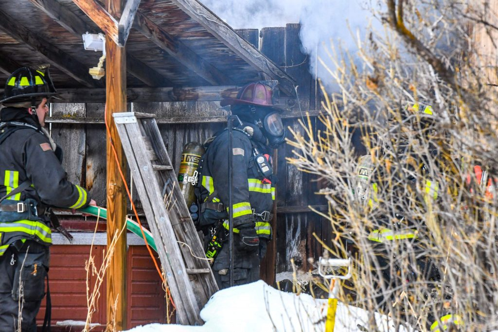 Glenwood Springs Firefighters work to extinguish a mobile home fire in the three-mile area just outside of Glenwood Springs City Limits on Tuesday morning.