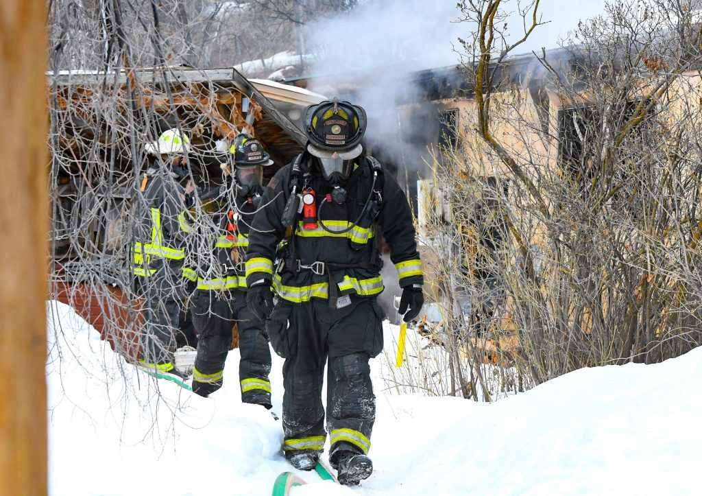 Glenwood Springs Firefighters work to extinguish a mobile home fire in the three-mile area of Glenwood Springs City Limits on Tuesday morning.