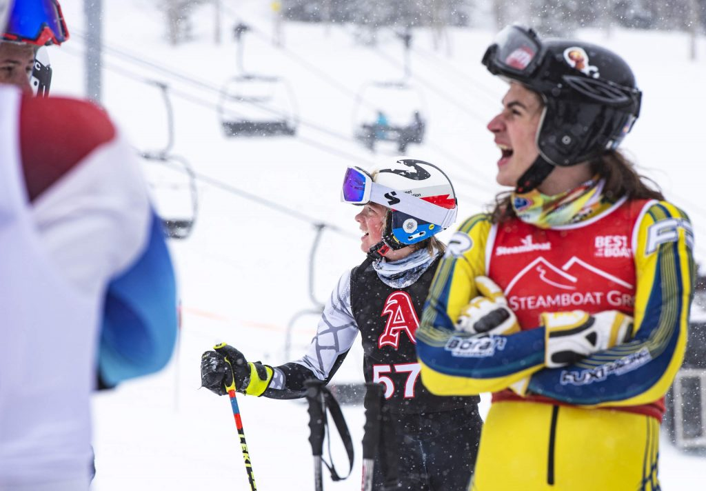 Aspen High School alpine team skier Jake Morgan, center, watches skiers compete during the first run of the Aspen High School giant slalom at Aspen Highlands on Thursday, Feb. 6, 2020. (Kelsey Brunner/The Aspen Times)