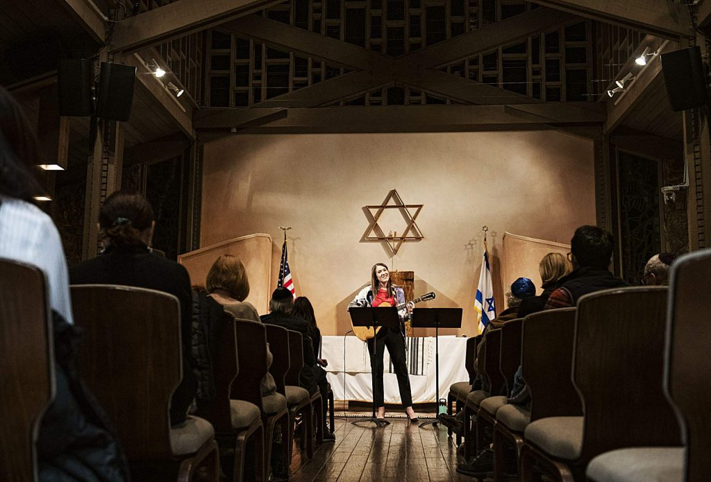 Rabbi Emily Segal leads a congregation through a Friday evening Shabbat at the Aspen Chapel.