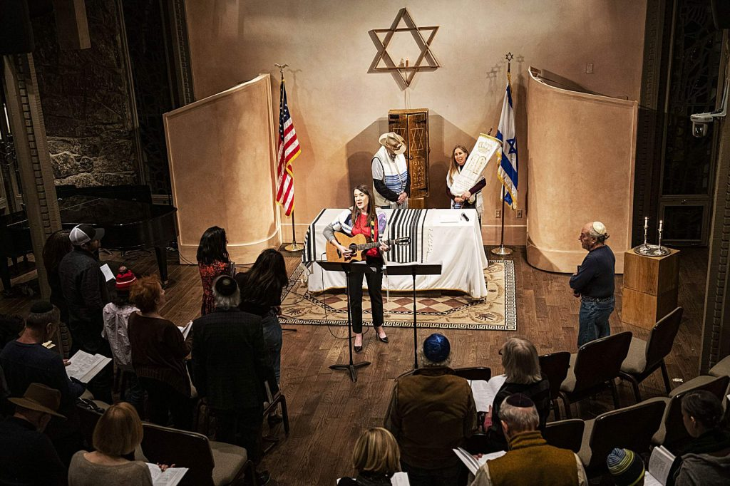 Rabbi Emily Segal leads a congregation through a Friday evening Shabbat at the Aspen Chapel..
