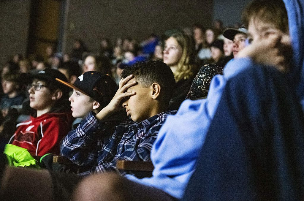 Aspen Middle School students watch an emotional film about the Holocaust at the end of the Remembrance Day Ceremony in the Aspen District Theater on Thursday, Jan. 30, 2020. January 27th has been designated by the United National as a day of commemoration to the victims of the Holocaust and as a day to educate about the genocide. This year is the 75th anniversary of the closing of Auschwitz death camp. (Kelsey Brunner/The Aspen Times)