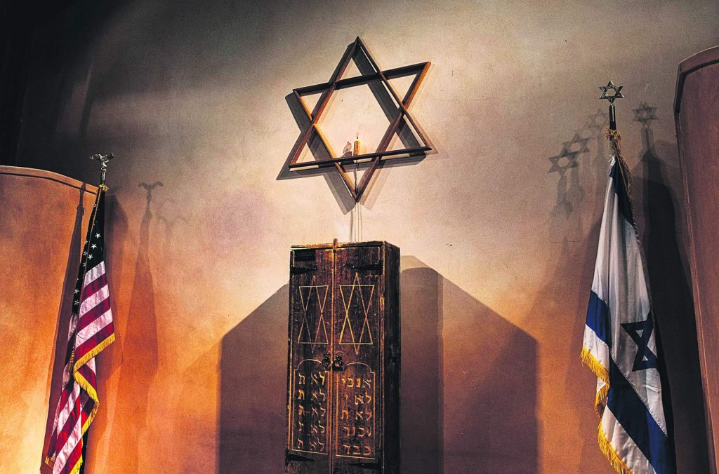 The Star of David hangs on the wall of the Aspen Chapel during a Friday night Shabbat.
