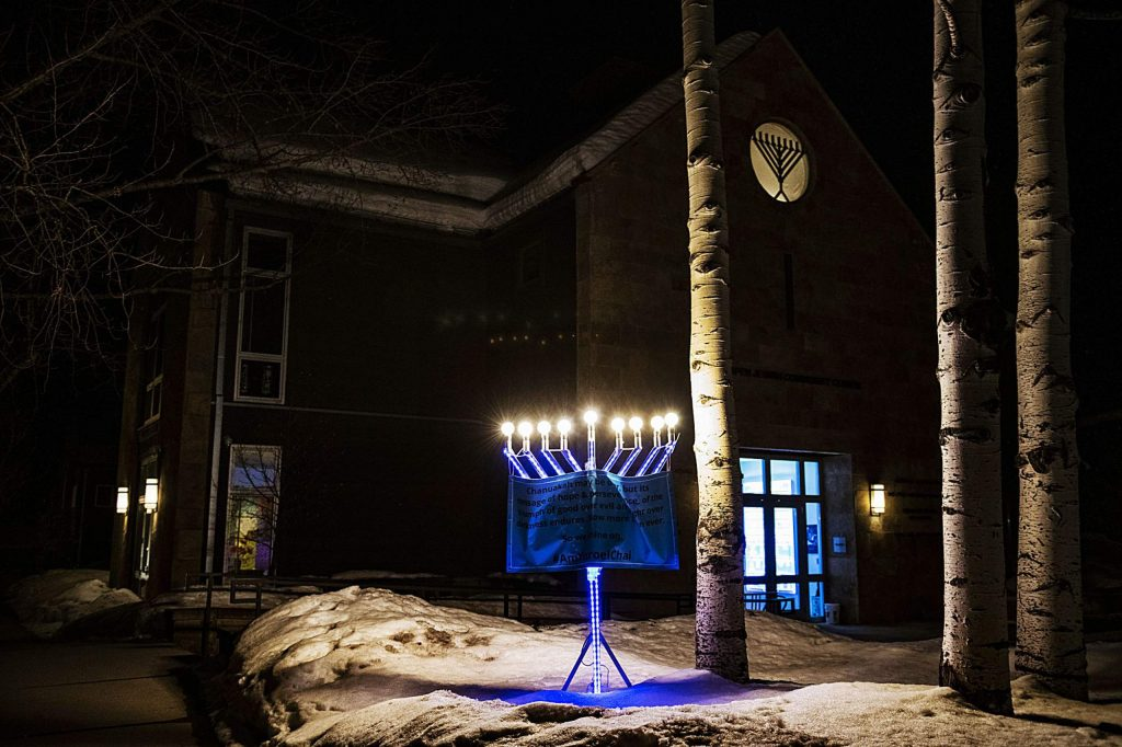 A menorah glows outside of the Aspen Jewish Community Center on a Saturday evening.