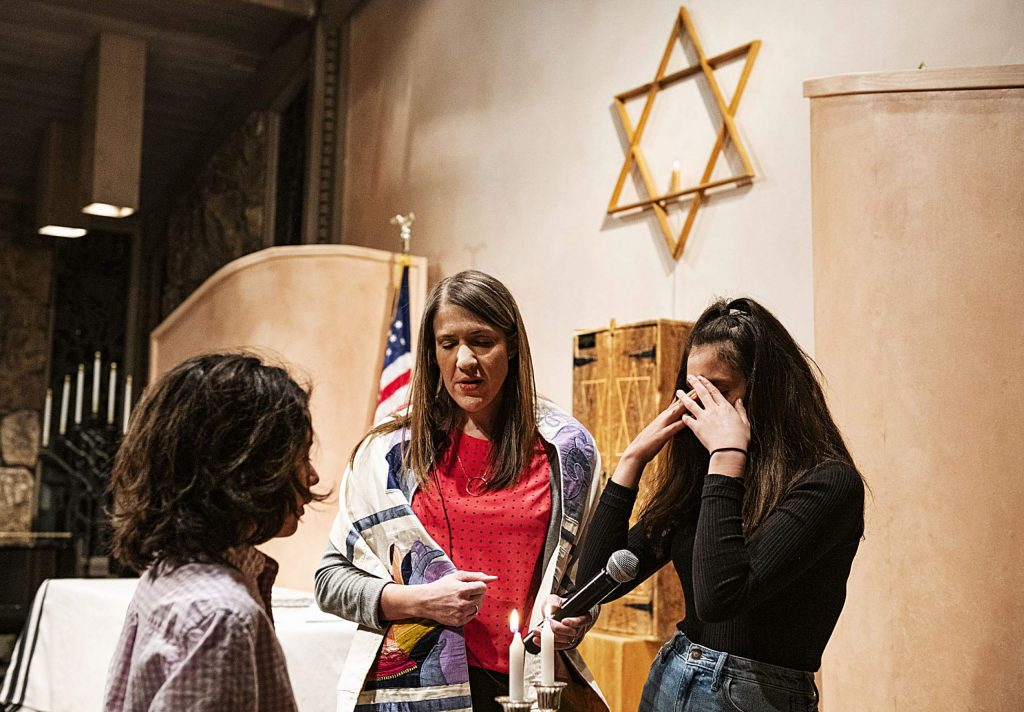 Rabbi Emily Segal leads a Shabbat candle ceremony at the Aspen Chapel.