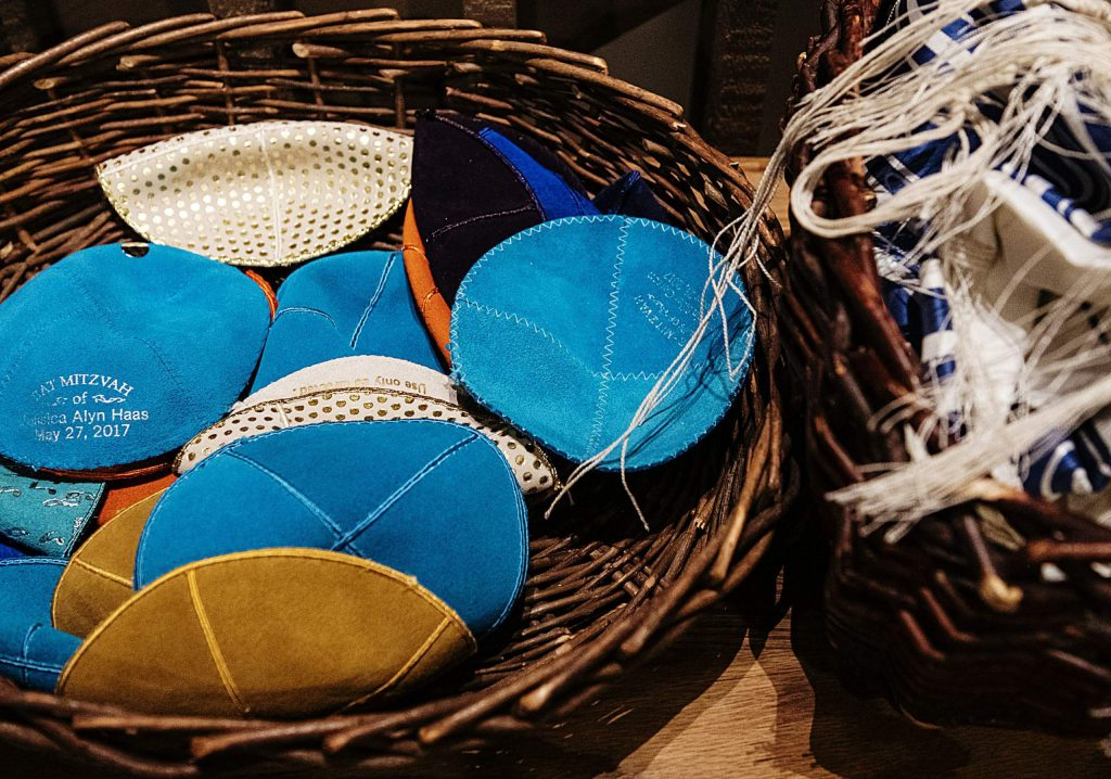 A basket of yarmulkes sit by the front entrance of the Aspen Chapel before Friday Shabbat service.