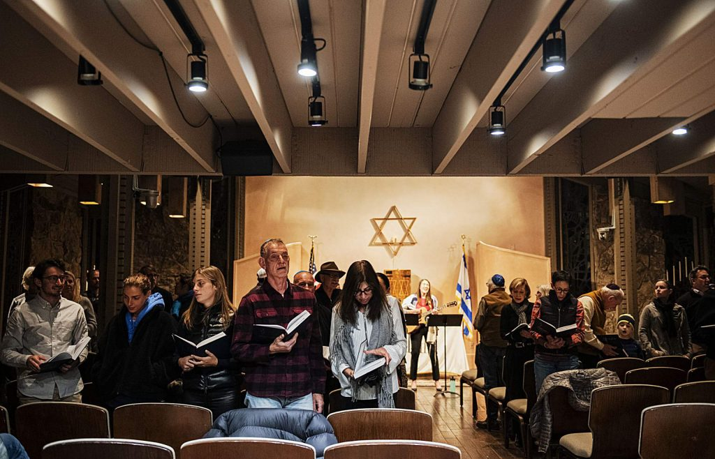 A congregation sings during a Friday night Shabbat service at the Aspen Chapel.