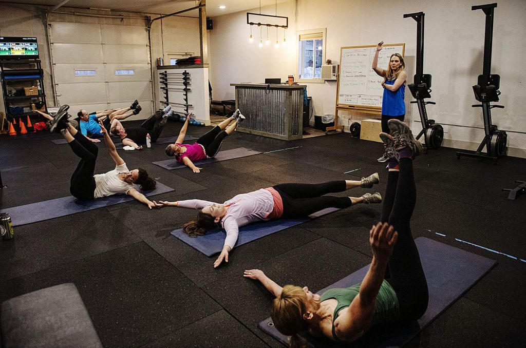Elevate Fitness trainer Bonnie Webb explains the movement for the ab exercise at the end of the HIIT class in the gym in Basalt on Friday, Feb. 14, 2020. (Kelsey Brunner/The Aspen Times)