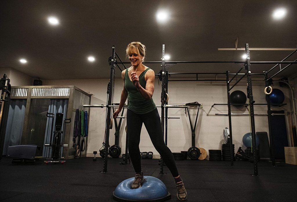Susie Hessel completes a tabata routine during a 6 a.m. HIIT workout at Elevate Fitness in Basalt on Friday, Feb. 14, 2020. (Kelsey Brunner/The Aspen Times)