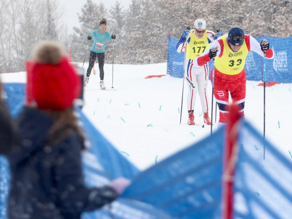 Spectators watch as racers approach the finish line of the Owl Creek Chase on Sunday, Feb. 9, 2020, in Aspen.