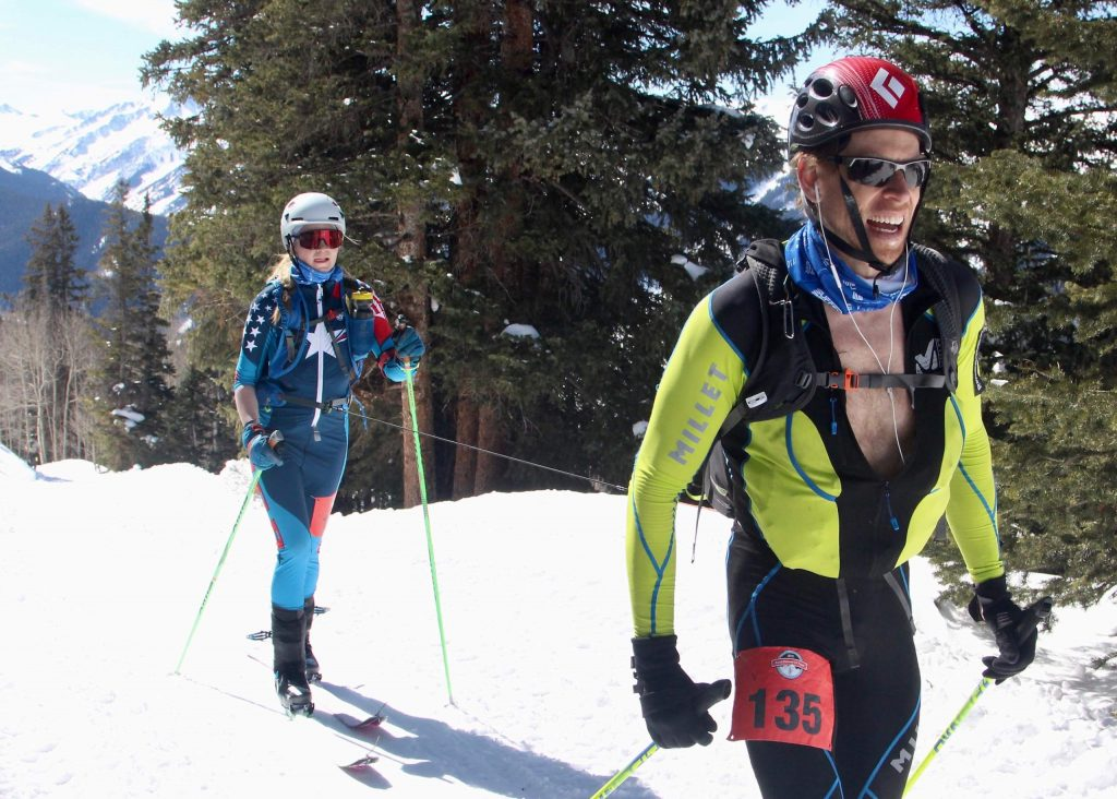 Elliott Bates, right, and Elsa Bates make it up Aspen Mountain during the Audi Power of Four ski mountaineering race on Saturday, Feb. 29, 2020, in Aspen. They finished second in the co-ed division. (Photo by Austin Colbert/The Aspen Times)