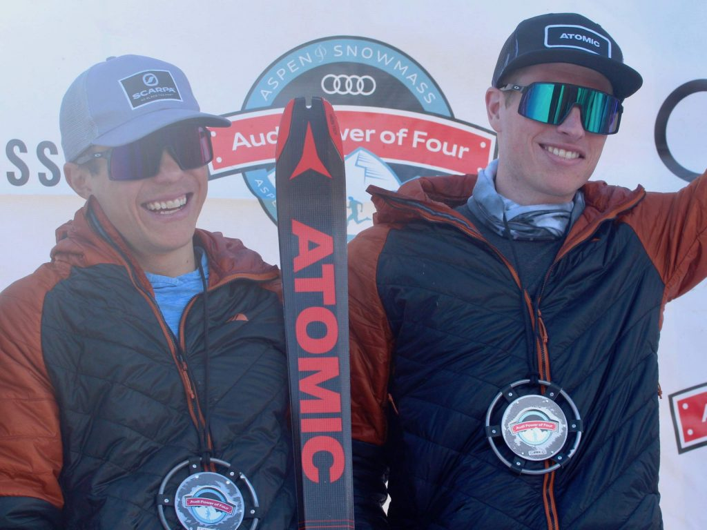 Max Taam, left, and John Gaston pose on the podium after winning the 10th annual Audi Power of Four ski mountaineering race on Saturday, Feb. 29, 2020, in Aspen. (Photo by Austin Colbert/The Aspen Times)