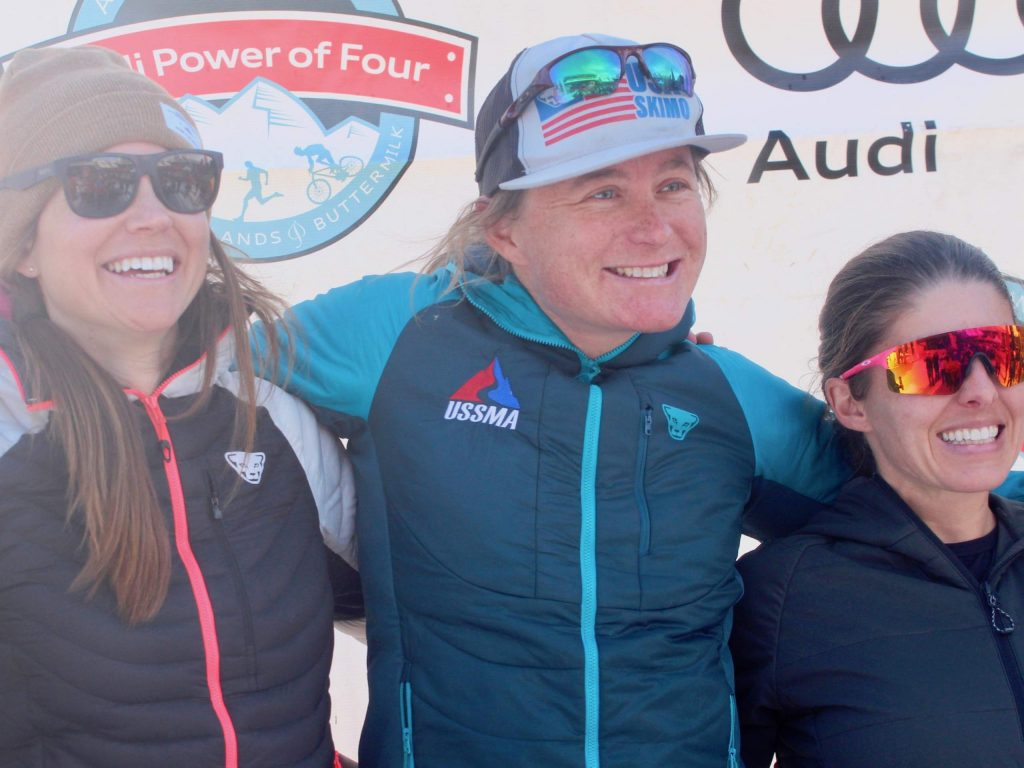 Jill Seager, left, and Kate Zander, middle, stand on the podium after winning the women's division of the 10th annual Audi Power of Four ski mountaineering race on Saturday, Feb. 29, 2020, in Aspen. At right is Aspen's Jessie Young, who along with Nikki LaRochelle finished second. (Photo by Austin Colbert/The Aspen Times)
