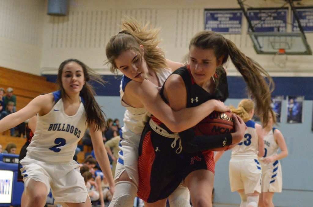 The Aspen High School girls basketball team plays at Moffat County earlier this season.