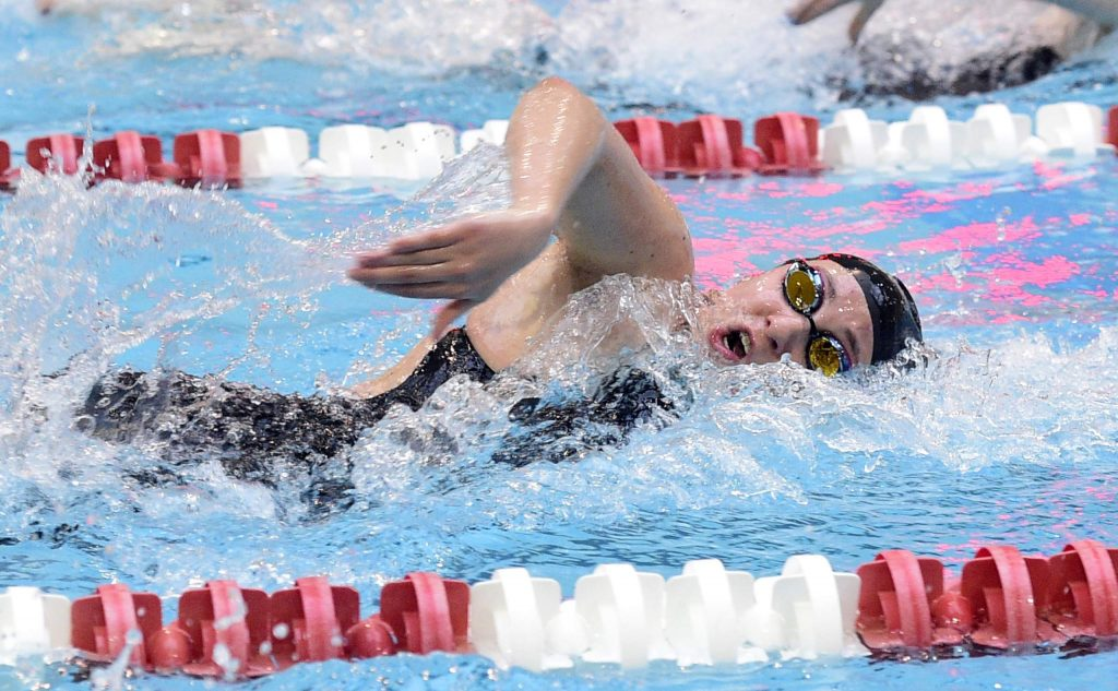 Aspen's Laila Khan-Farooqi competes in the 200-yard freestyle at the Class 3A state swim championships on Saturday in Thornton. (Cliff Grassmick/Boulder Daily Camera)