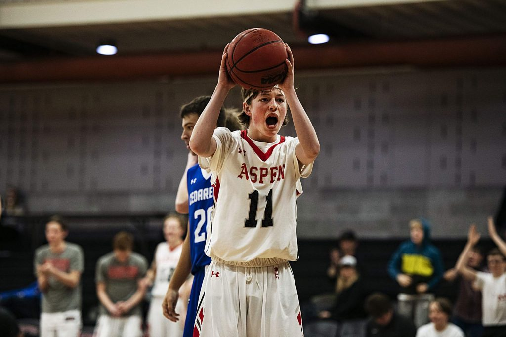 Aspen's Liam Farrey (11) celebrates after a play during the game against Cedaredge on Saturday, Feb. 22, 2020. (Kelsey Brunner/The Aspen Times)
