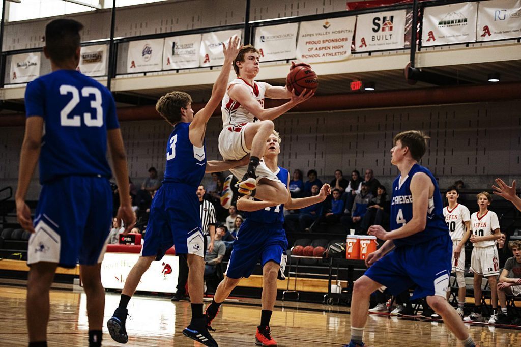 Aspen's Jack Seamans (2) goes for a layup during the game against Cedaredge on Saturday, Feb. 22, 2020. (Kelsey Brunner/The Aspen Times)