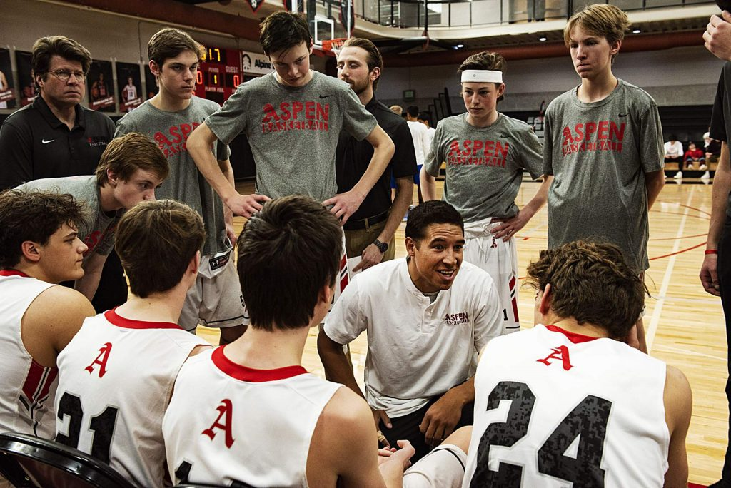 Aspen High School boys basketball head coach Alex Schrempf, center, gives a talk before the start of the playoff game against Cedaredge High School on Saturday, Feb. 22, 2020. (Kelsey Brunner/The Aspen Times)