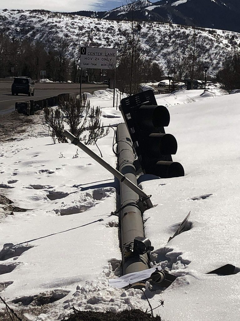 The stoplight pole that was damaged Feb. 5 by a city of Aspen snow truck remains on the side of Highway 82 just past the intersection for the Aspen airport. A highway crew looked at the pole late last week to determine if it could be re-used, but they won't know until next week, officials said.