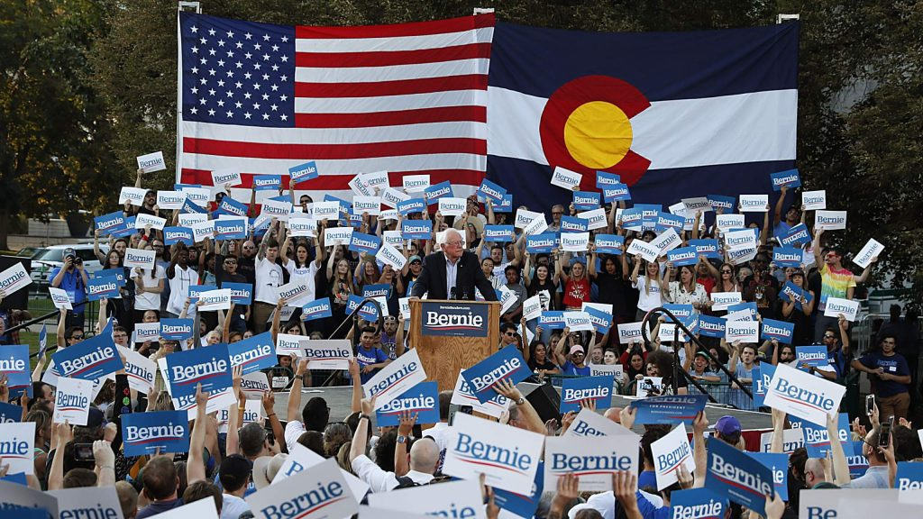 Democratic presidential candidate Sen. Bernie Sanders, I-Vt., center, speaks during a rally at a campaign stop Monday, Sept. 9, 2019, in Denver. (AP Photo/David Zalubowski)