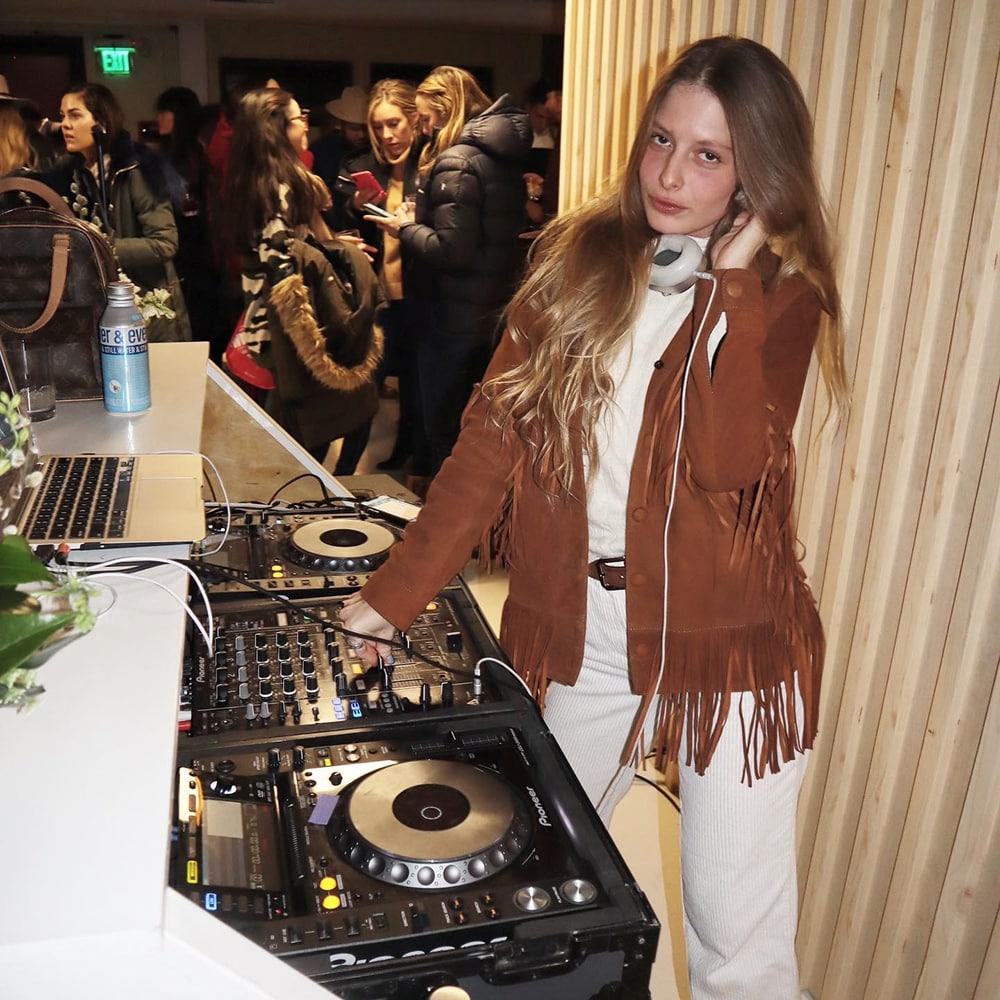 Model/stylist/DJ - Pamela Tick does it all. Seen here playing at the Away Chalet over Presidents' Day weekend.