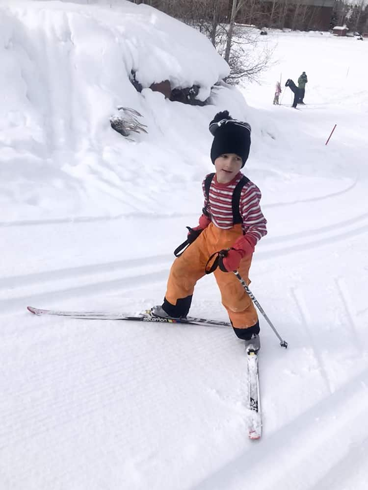 Staying active, but staying apart from others, is a great way to spend time these days, as shown by little ripper Max Poole charging uphill on his cross-country skis.