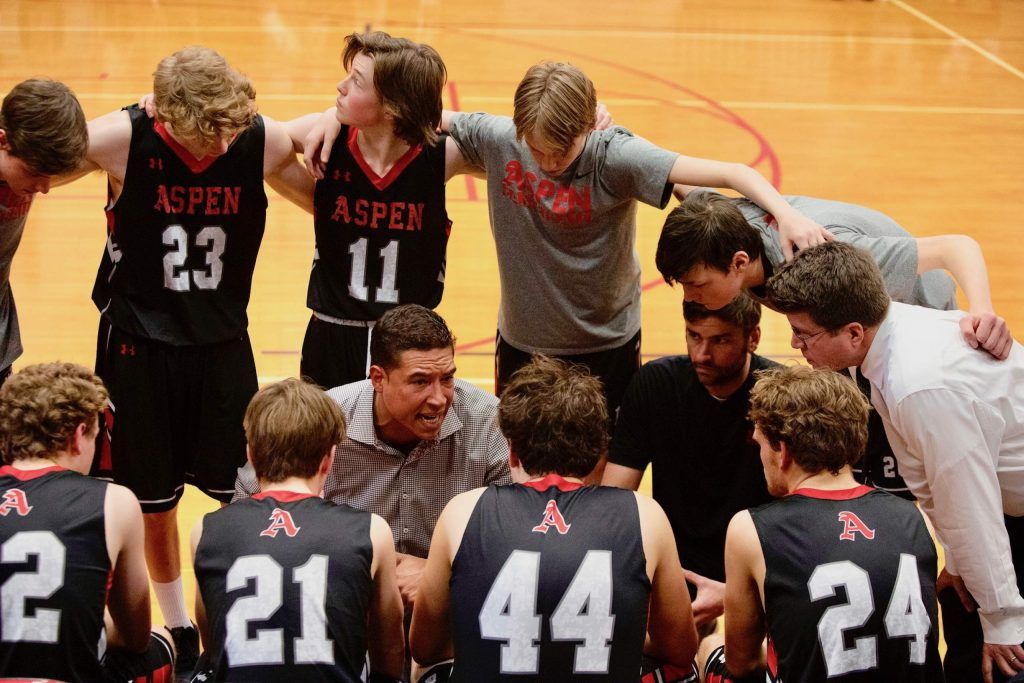 Aspen High School boys basketball coach Alex Schrempf talks to the players during a timeout Saturday, Feb. 29, 2020, in the Class 3A district title game against Gunnison at Grand Junction Central High School. (Photo by McKenzie Lange/The Daily Sentinel)