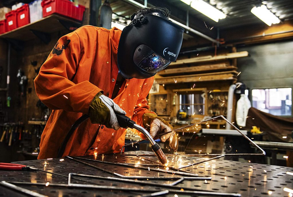 Sculpture artist Michael Loveland welds pieces for his work at Anderson Ranch in Snowmass on Friday, Feb. 21, 2020. (Kelsey Brunner/The Aspen Times)